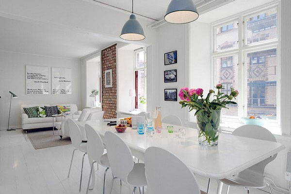 interior design dining room stylishly decorated with pale walls, white painted wooden floors and rustic brick walls