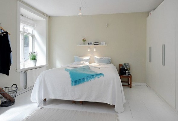 interior design white a bedroom with large windows with natural lighting