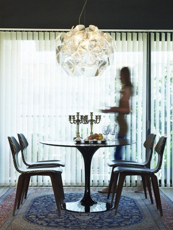 the unique design of the dining room and simple but luxurious impressed equipped with a beautiful chandelier, aparment