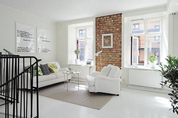 the unique duplex apartment that impresses due to a simple, but charming white color scheme