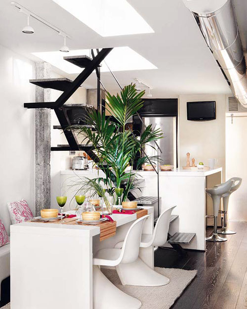 trendy dining room interior with stairs in Incredible Duplex Apartment Madrid