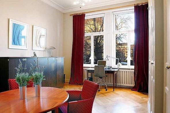 Beautiful red sofa Traditional Swedish Apartment